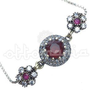 Srebrna drobna bransoletka z rubinami i akcentami bronzu