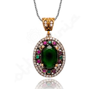 Owalny, srebrny naszyjnik ze szmaragdami i rubinami