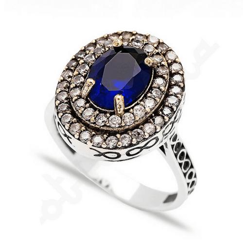 Owalny srebrny pierścień z szafirem